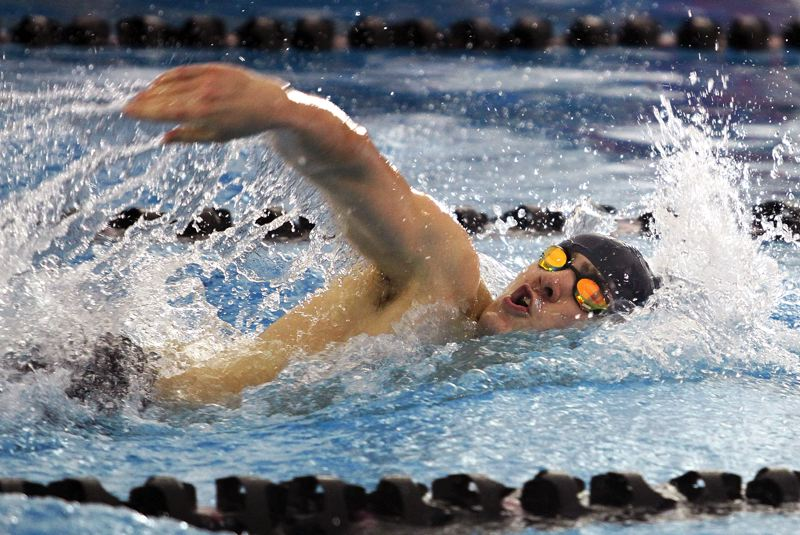 REVIEW PHOTO: MILES VANCE - Lake Oswego senior Doug Heymann races to third place in the 200-yard freestyle at the Class 6A state championship at Mt. Hood Community College Aquatic Center on Saturday.