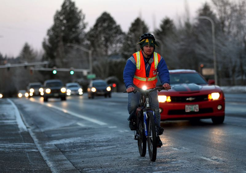 TIMES PHOTO: JAIME VALDEZ - A bicyclist makes his was along the icy Southwest Scholls Ferry Road early Wednesday.