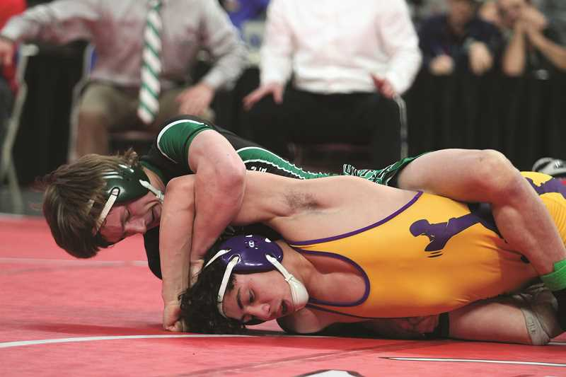 PHIL HAWKINS - North Marion senior Brandon GIbson pushed defending state champion A.J. Lira of Marshfield to the brink in a 2-1 loss in the final match of the 4A 138-pound bracket on Saturday.
