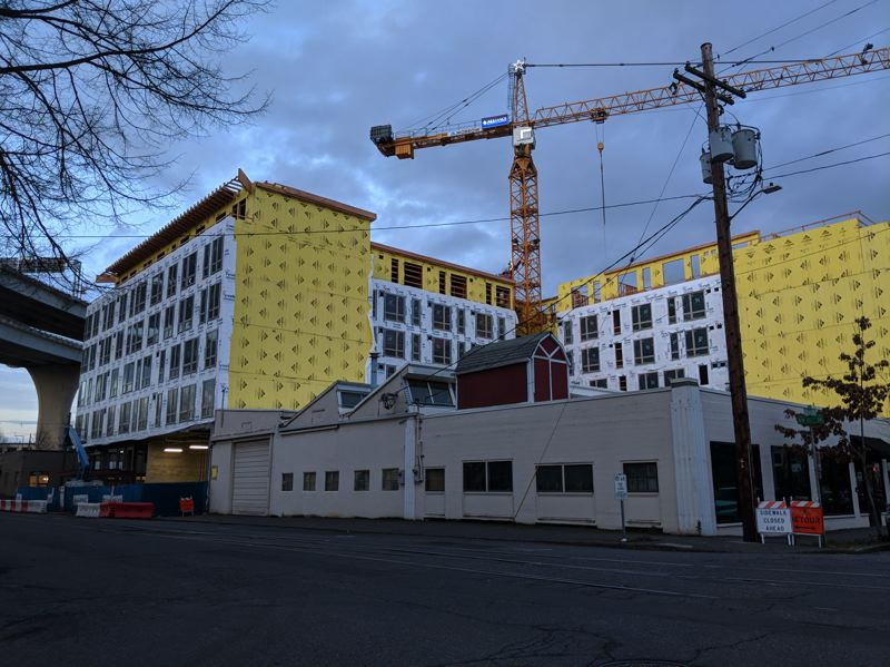 PAMPLIN MEDIA GROUP: JOSEPH GALLIVAN - The Broadstone Pearl is being built in an L shape around property which the owners did not wish to sell. Portland rock band The Dandy Warhols use it for practice and as a wine bar called Old Portland.