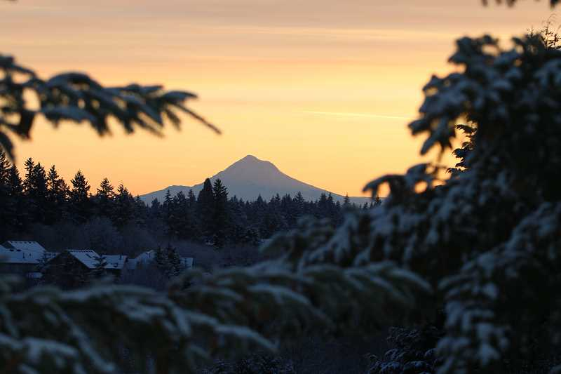 TIDINGS PHOTO: BRIAN MONIHAN - West Linn residents were greeted with a beautiful sunrise and clear view of Mt. Hood Wednesday morning along with about an inch of snow.