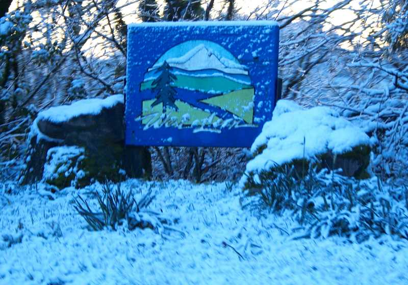 TIDINGS PHOTO: BRIAN MONIHAN - The welcome to West Linn sign near the Abernethy Bridge paints a picture of how much snow fell on the city Tuesday night and early Wednesday morning.