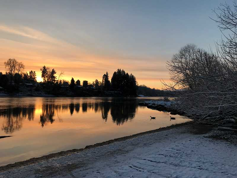 PAMPLIN MEDIA GROUP PHOTO: SHASTA KEARNS MOORE - The sun rises over the river in West Linn Feb. 21.