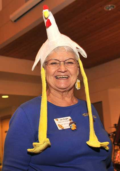Volunteer Jan Engler got in the mood (for the Chicken Dance, no doubt) as she worked the sauerkraut feed.