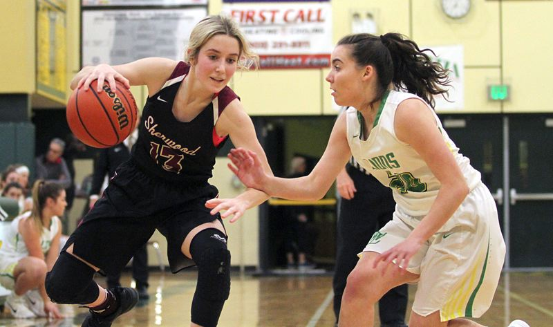 PAMPLIN MEDIA GROUP: MILES VANCE - Sherwood senior Lauren Scarvie (left) looks to get past West Linns Cami Fulcher during Friday's Three Rivers League game.