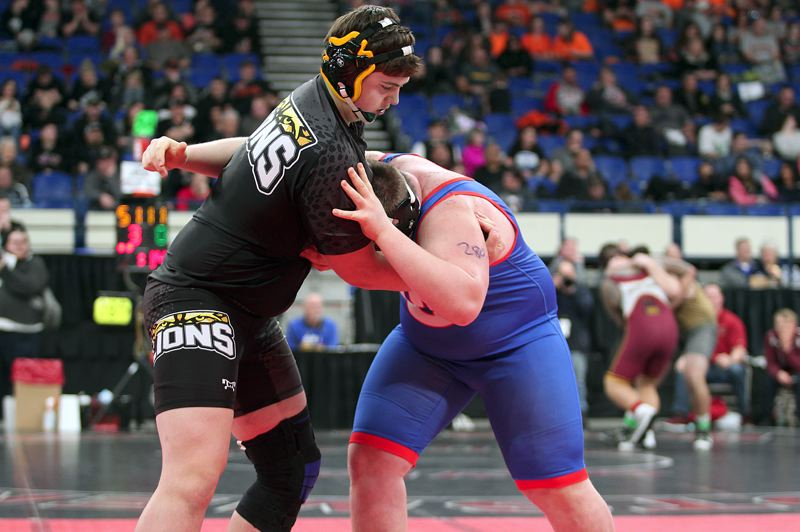 SPOTLIGHT PHOTO: PHIL HAWKINS - St. Helens senior Caleb Carter (left) stepped up and wrestled his way to sixth place at 285 pounds at the Class 5A state tournament at Veterans Memorial Coliseum on Friday and Saturday.