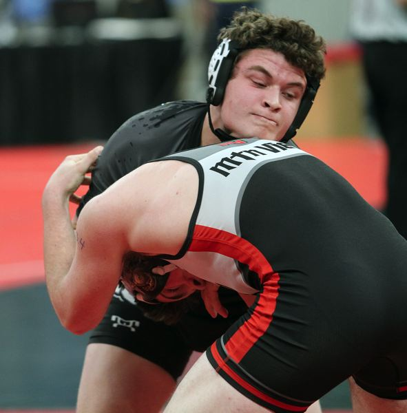 SPOTLIGHT PHOTO: MILES VANCE - St. Helens sophomore Ryan Burri battles against Mountain View's Carson Fassett during their first-round match at 152 pounds during the Class 5A state tournament on Friday.
