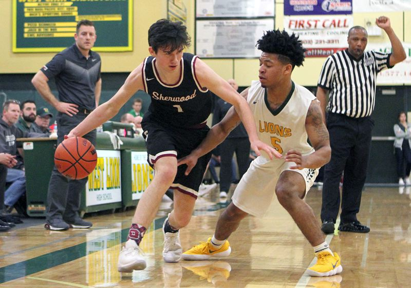 PAMPLIN MEDIA GROUP PHOTO: MILES VANCE - Sherwood senior Billy Hale (left) drives during his team's 62-51 loss at West Linn on Friday night.