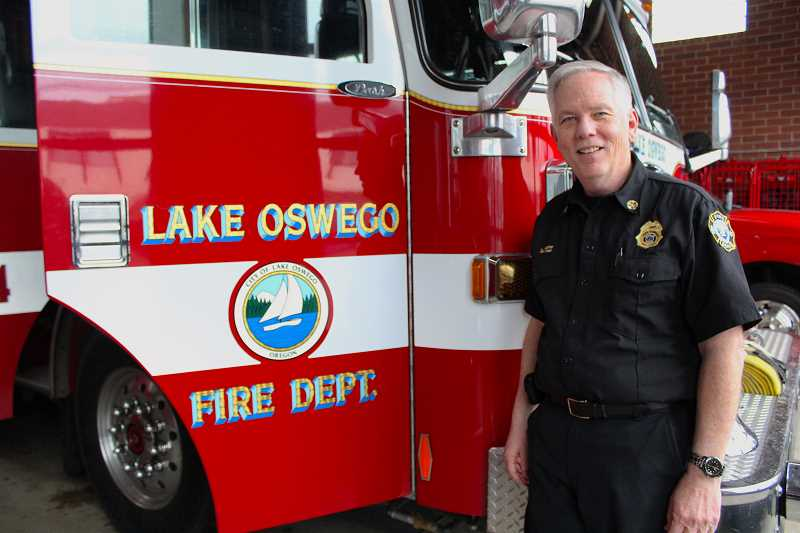 REVIEW PHOTO: SAM STITES - Lake Oswego Fire Chief Larry Goff poses next to an engine at the Main Fire Station on B Avenue.