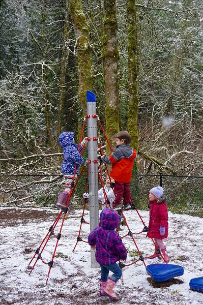 REVIEW PHOTO: CLAIRE HOLLEY - Preschoolers at the International Leadership Academy in Lake Oswego play on one of the school's jungle gyms during a break from class this week.