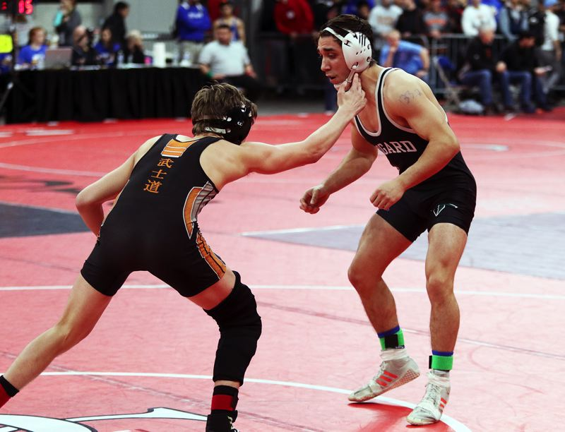 DAN BROOD - Tigard junior Emilio Jimenez (right) competed at 132 pounds at the Class 6A state tournament.