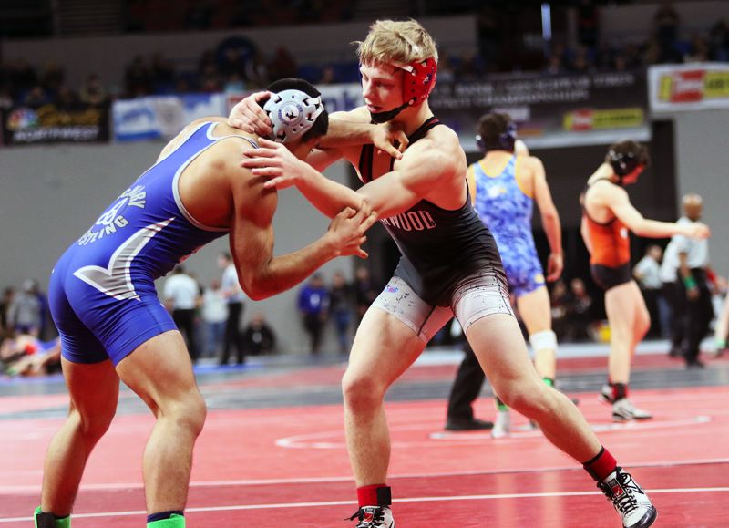 DAN BROOD - Sherwood junior Gaven Jolley (right) is on his way to getting a win in the 126-pound third-place match at the Class 6A state tournament.