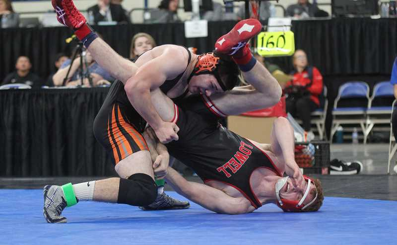 WILL DENNER/MADRAS PIONEER - Jerron Rhen flips Lowell's Nate Roat late in the 160 finals match.?