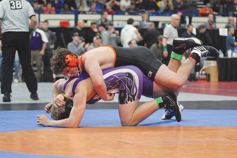 WILL DENNER/MADRAS PIONEER - Cylus Hoke pounces on Elgin's Clayton Hammond during the 195 semifinals.