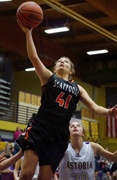 FOR THE SPOTLIGHT: ROBERT HILSON - Payton Fisher goes for a layup for the Scappoose Indians in their Cowapa League playoff game against Astoria.