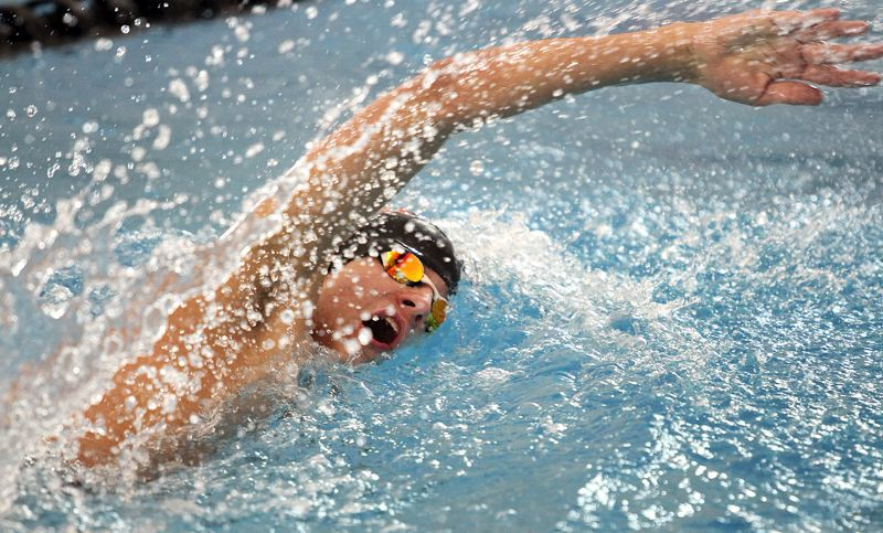 SPOTLIGHT PHOTO: MILES VANCE - Scappoose freshman Will Blair races in the 200-yard freestyle relay during the Class 4A/3A/2A/1A state meet at Mt. Hood Community College Aquatic Center on Friday and Saturday.