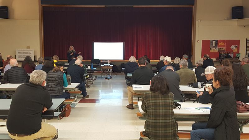 SUBMITTED PHOTO - Executive Director Krystyna Wolniakowski addresses a crowd of residents at the Corbett School multi-purpose building on Tuesday, Feb. 6.