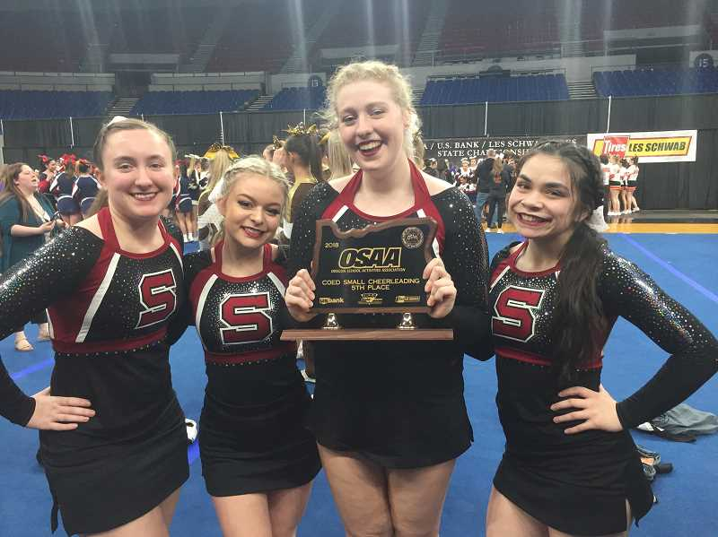 COURTESY: MINDI ARMATAS - Sherwood High seniors Madison Moriello, Cayla Basta, Whitney Groeger and Lynda Alboro competed in the OSAA state cheerleading championships.