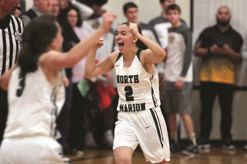 PHIL HAWKINS - North Marion senior Ally Umbenhower celebrates after the Huskies defeated the No. 3 Cascade Cougars on Tuesday. North Marion had lost eight straight games to Cascade since joining the Oregon West Conference in 2015.