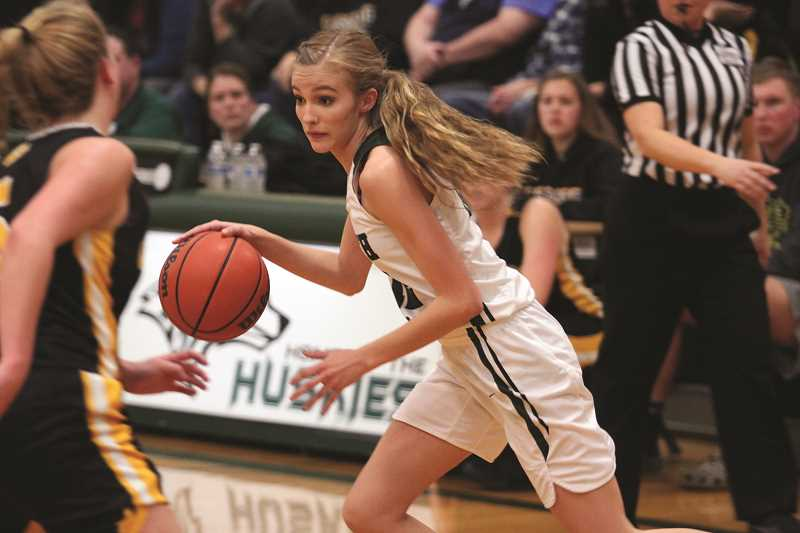 PHIL HAWKINS - North Marion sophomore Katie Ensign hit the game-winning free throws with seven seconds left to put the Huskies up 54-52. Ensign finished with 10 points.