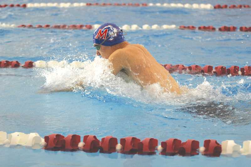 WILL DENNER/MADRAS PIONEER - Madras senior Kyle Hartman swims the breaststroke leg of the 200 boys medley relay Friday afternoon at Mt. Hood Community College in Gresham.