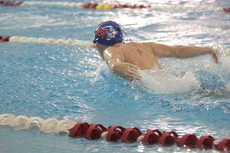 WILL DENNER/MADRAS PIONEER - Madras sophomore Teague Schierling swims the butterfly in the 200 boys medley relay.