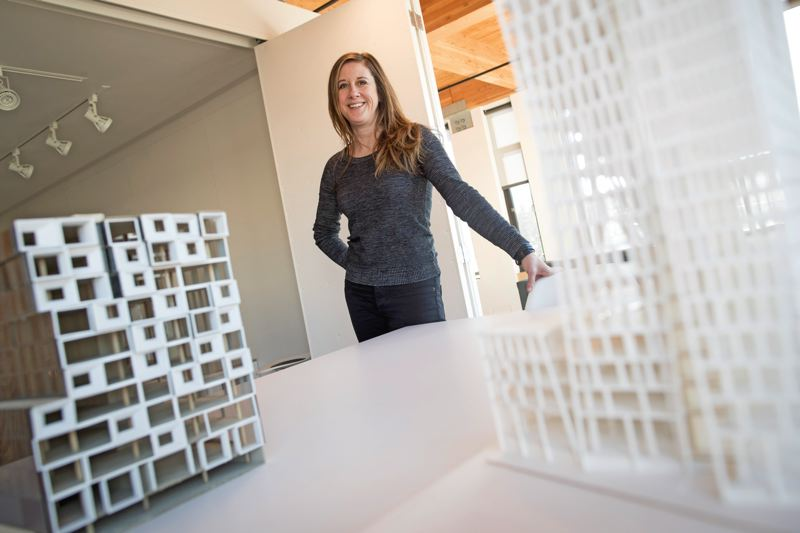 PAMPLIN MEDIA GROUP: JAIME VALDEZ - Carrie Strickland in the W.PA offices with building models. Strickland's firm has expanded to big developments in the Los Angeles Arts District and Denvers trendy RiNo, where they are prototyping a music venue for distributor AEG which can be replicated in dozens of other cities.