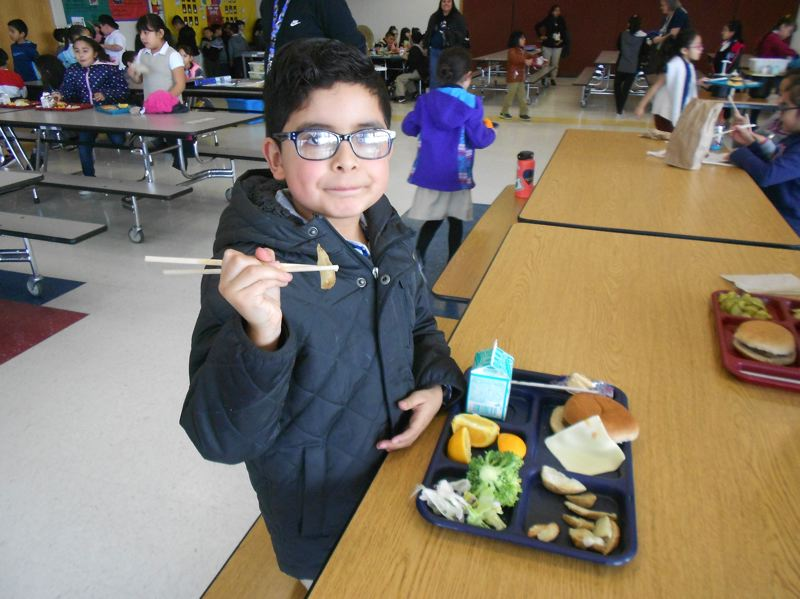 COURTESY PHOTO: CHERYL HALL - Giovanni Gonzalez, a student at Cornelius Elementary School, shows off his use of chopsticks to eat school lunch.