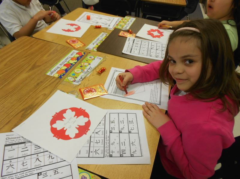 COURTESY PHOTO: CHERYL HALL - Cornelius Elementary School student Niema Porter colors during a Chinese New Year activity.