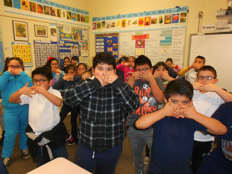 COURTESY PHOTO: CHERYL HALL - Second-graders at Cornelius Elementary School practice tai chi, one of the China-themed activities they have been doing to mark the Chinese New Year holiday.