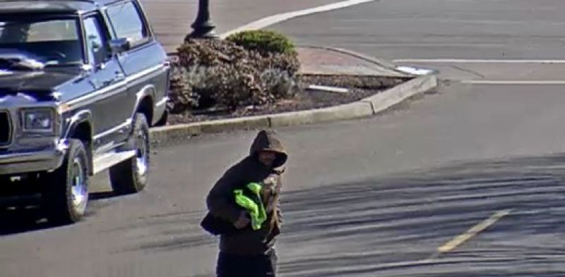 COURTESY PHOTO: CITY OF WOODBURN - One of two images capturing the suspect in Thursday's alleged armed robbery at the Greyhound bus station in downtown Woodburn.