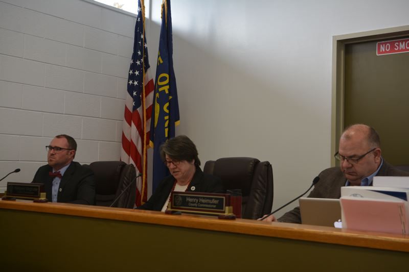 SPOTLIGHT PHOTO: COURTNEY VAUGHN - Columbia County Commissioners Alex Tardif, Margaret Magruder and Henry Heimuller meet Wednesday, Feb. 21, to give final approval to an ordinance allowing more than 830 acres of farmland to be rezoned for industrial use.
