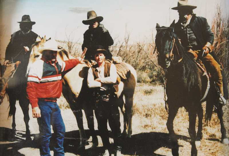 PHOTO COURTESY OF LYNN TROUPE - Lynn Troupe (far right) is photographed with actor Emilio Estevez and other crew from the movie 'Young Guns.' Troupe served as a stuntman in the movie.