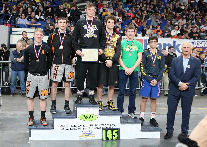PAMPLIN MEDIA GROUP PHOTO: JIM BESEDA  - Molalla senior Ryan Mount (second from left) and Ben Pruitt (far Left) took third and fifth, respectively, in