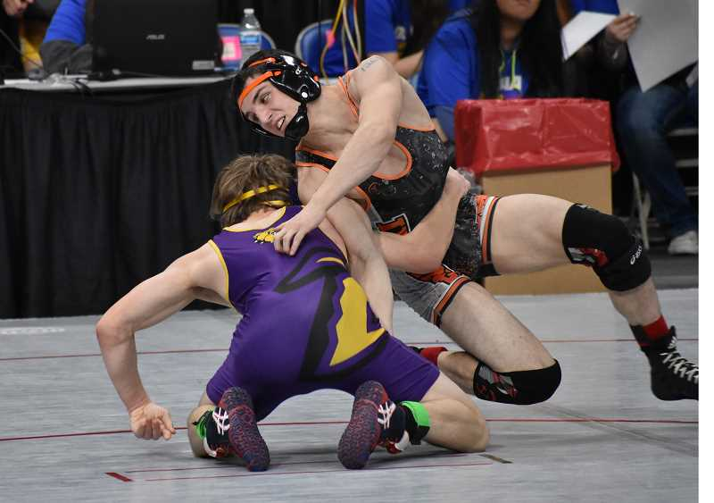 SUBMITTED PHOTO: BRIAN MOUNT  - Molalla sophomore Max Tate (right) moves to take top position on