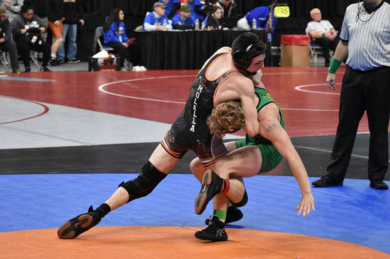 SUBMITTED PHOTO: BRIAN MOUNT  - Molalla senior Ryan Mount (left) takes down Sweet Home's Zak Fox in the first round of the OSAA State