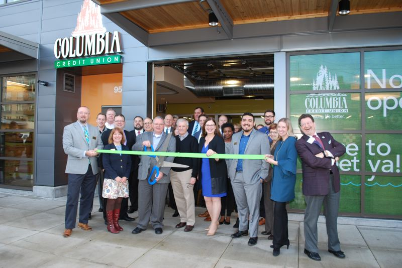 SUBMITTED: COLUMBIA CREDIT UNION - Columbia Credit Union staffers and directors, neighbors, business partners and nonprofit representatives gathered for a ribbon-cutting ceremony in late January.