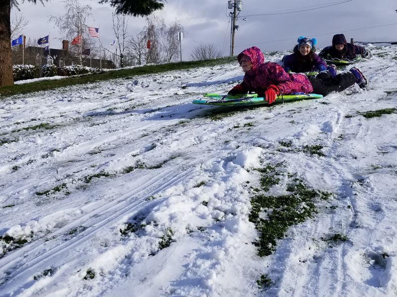 OUTLOOK PHOTO: STEVE KEIZUR - Kids sledding!