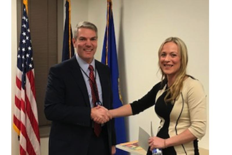 PHOTO COURTESY: FBI - Esther Nelson receives the Community Leadership Award from Assistant Special Agent in Charge Steve Palmer of the FBI's Portland Division on Jan. 18 during the local presentation. She will receive the award from FBI Director Chris Wray himself at the national ceremony later this spring.