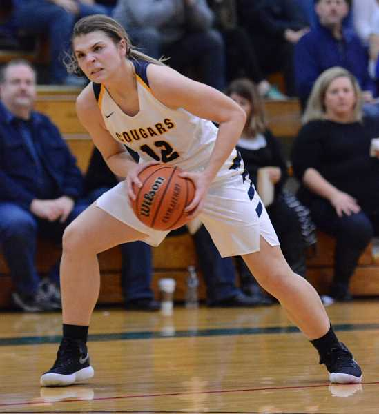 PAMPLIN MEDIA GROUP PHOTO: DAVID BALL - Country Christian junior Sarah Phillips looks to make a move to the basket during the