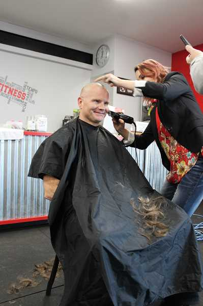 PIONEER PHOTO: KRISTEN WOHLERS - Sheldon Sanders got his head shaved on Feb. 23 to raise funds for Share the Love recipients.