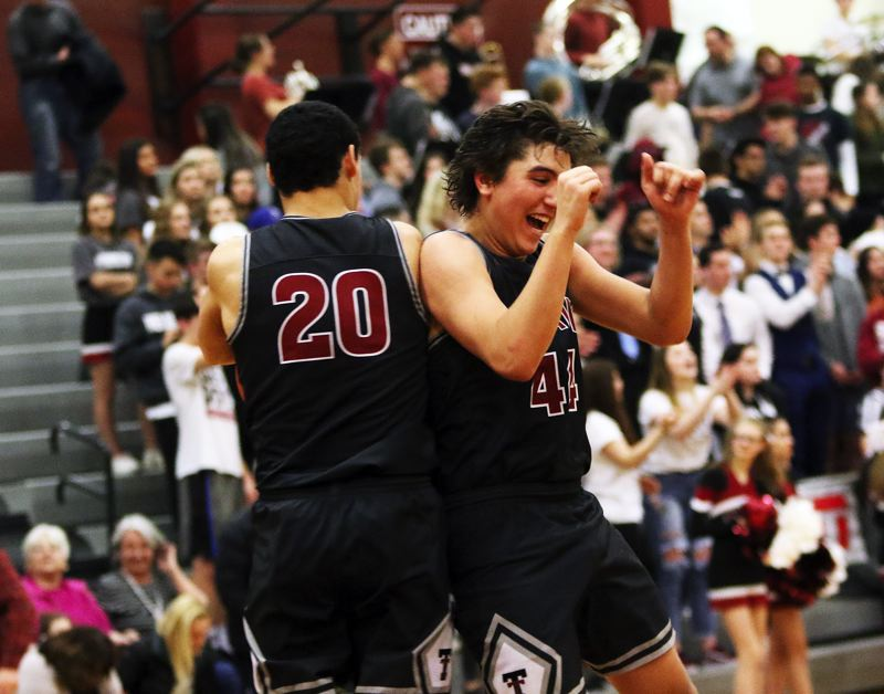 DAN BROOD - Tualatin sophomore John Miller (left) and junior Bridger Steppe celebrate following the Wolves' double-overtime victory at Sherwood.