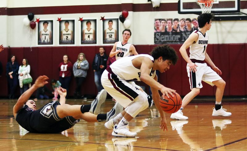 DAN BROOD - Sherwood sophomore Jamison Guerra gets control of a loose ball during Thursday's game.