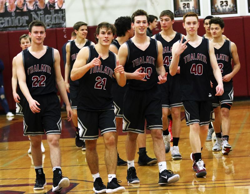 DAN BROOD - The Timberwolves are all smiles as they walk off the court following their 63-58 double-overtime victory at Sherwood on Thursday.