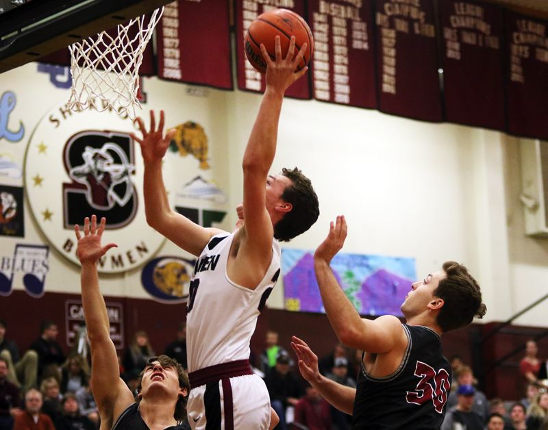 DAN BROOD - Sherwood senior Owen Grubbe goes to the basket during the Bowmen's game with Tualatin on Thursday.