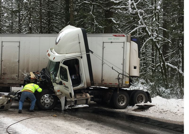 CONTRIBUTED PHOTO: HOODLAND FIRE DEPARTMENT - A semi truck driver was fortunately unharmed after crashing truck on icy patch on Highway 26.