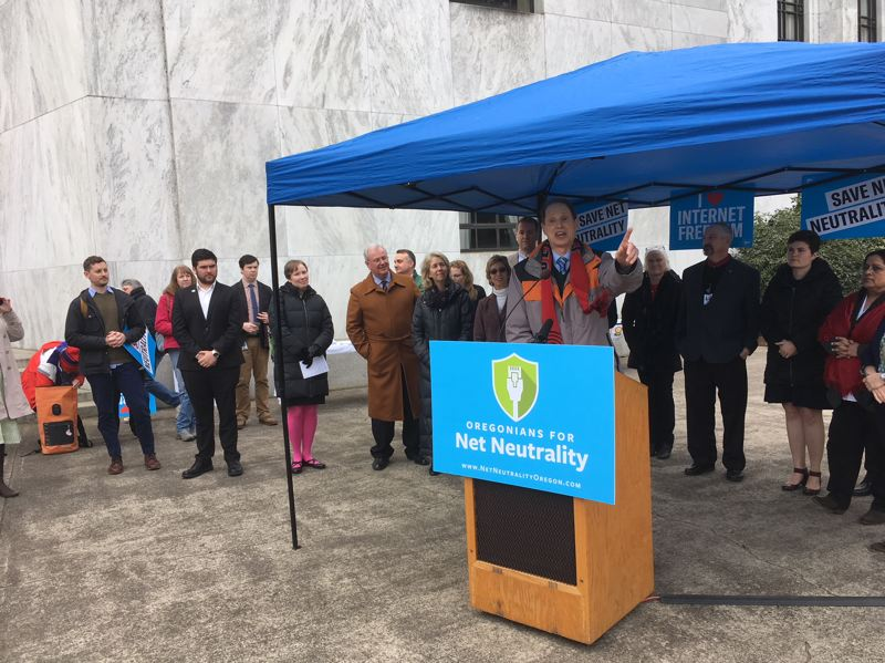 PAMPLIN MEDIA GROUP: PETER WONG - U.S. Sen. Ron Wyden, D-Ore., boosts the cause of net neutrality at a rally Friday, Feb. 23, at the Capitol in Salem. Federal net-neutrality rules are repealed, but Congress has 60 days to reinstate them; Oregon has pending legislation and a proposed ballot measure in addition to a joint lawsuit led by New York.