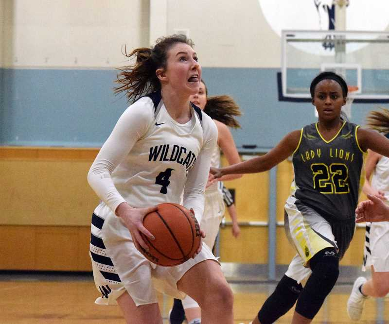 SPOKESMAN PHOTO: TANNER RUSS - Wilsonville junior Teegan McNamee was an active member of the teams defense, and contributed nine points to the Wildcats in their 58-35 win against the St. Helens Lions.