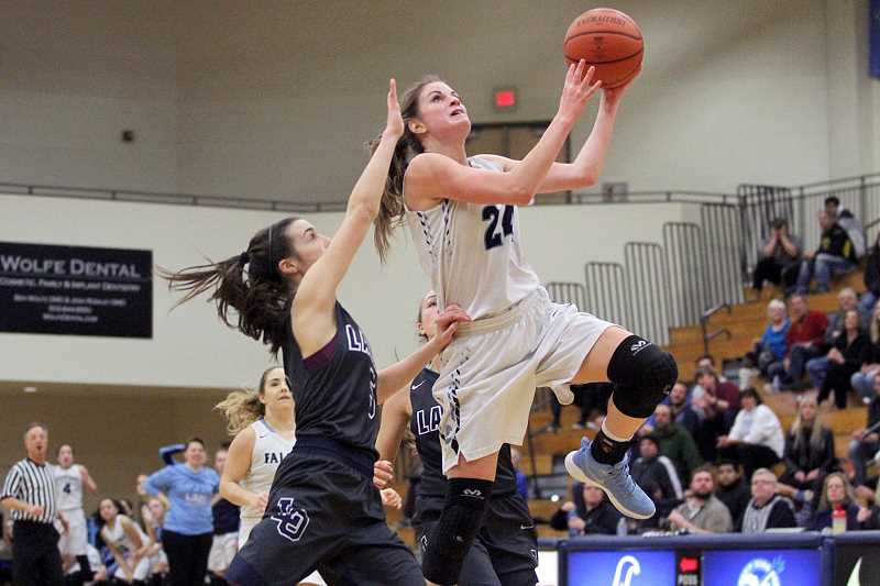 PAMPLIN MEDIA PHOTO: MILES VANCE - Liberty sophomore Clara Robbins goes up to score during her team's 67-41 win over Lake Oswego at Liberty High School in the Class 6A Play-In round on Saturday.