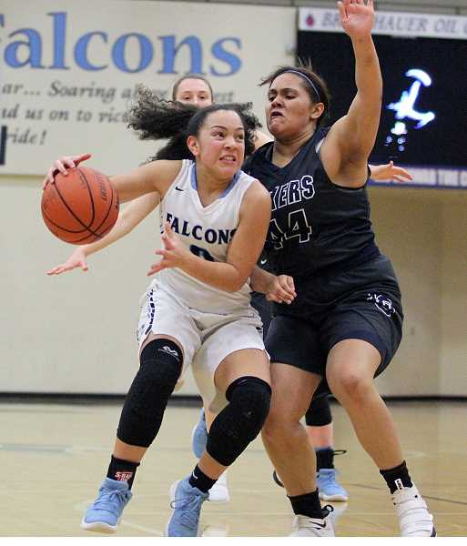 PAMPLIN MEDIA PHOTO: MILES VANCE - Liberty freshman Taylin Smith drives during her team's 67-41 win over Lake Oswego at Liberty High School in the Class 6A Play-In round on Saturday.